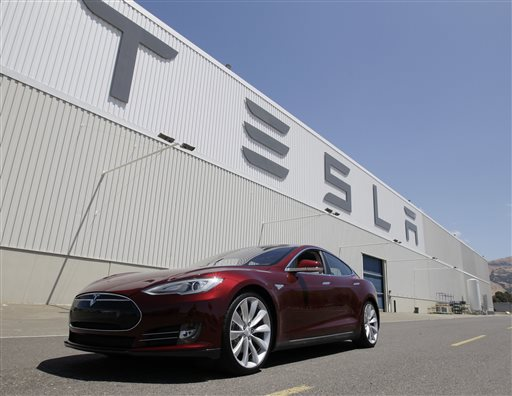 FILE - This June 22, 2012 file photo shows a Tesla Model S outside the Tesla factory in Fremont, Calif.