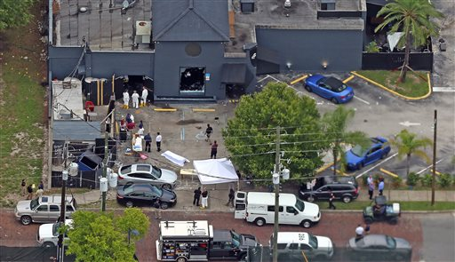 Aerial view Sunday, June 12, 2016 of the mass shooting scene at the Pulse nightclub in Orlando, Fla. A gunman opened fire inside a crowded gay nightclub early Sunday, before dying in a gunfight with SWAT officers, police said.