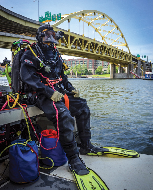 Crew chief and public safety diver Simon Taxel standing by ready to deploy. Photo courtesy Simon Taxel