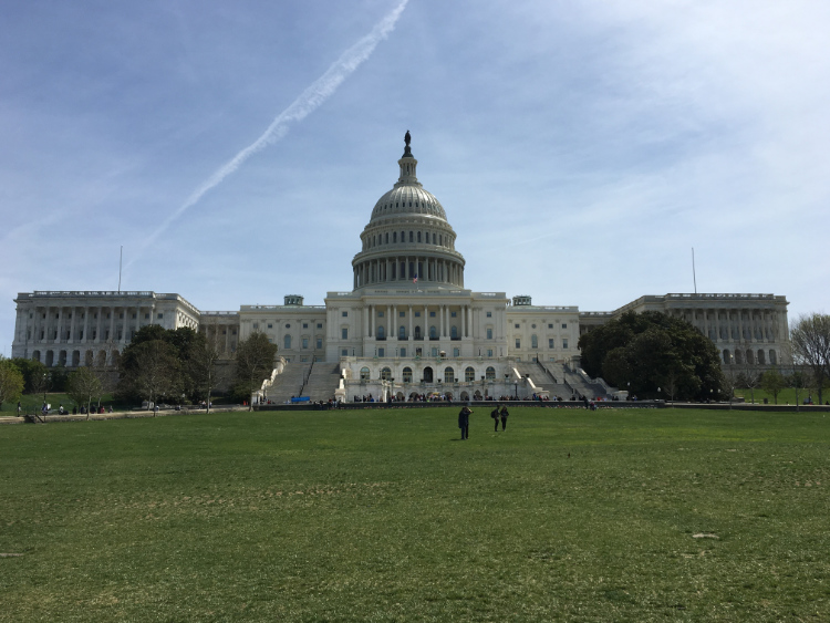 The photo shows the outside of the U.S. Capitol.