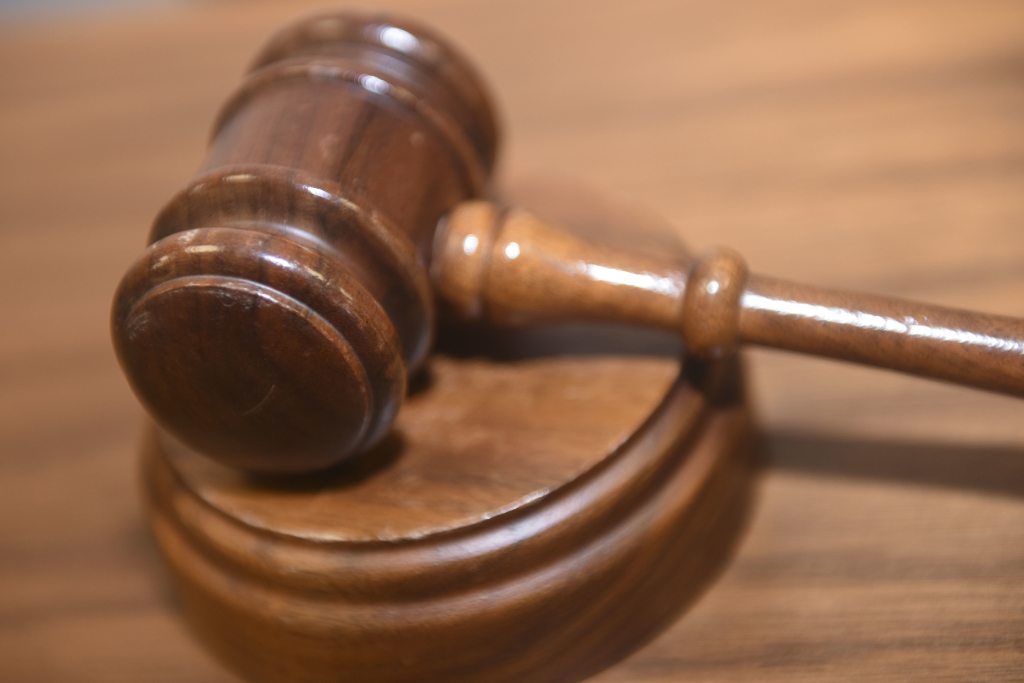 The photo shows a wooden gavel.