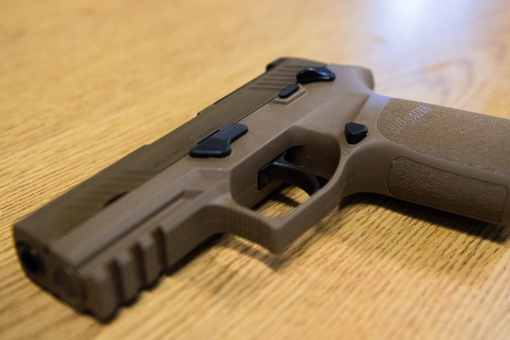 A handgun on a table.