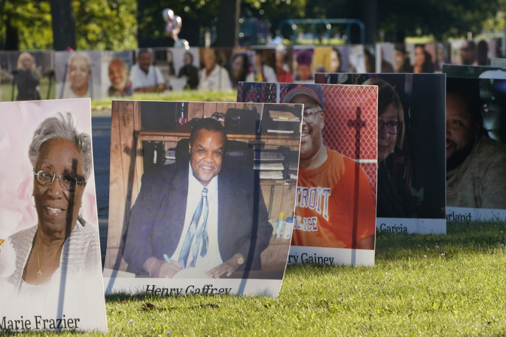 In this Monday, Aug. 31, 2020 file photo, some of the nearly 900 large poster-sized photos of Detroit victims of COVID-19 are displayed on Belle Isle in Detroit.