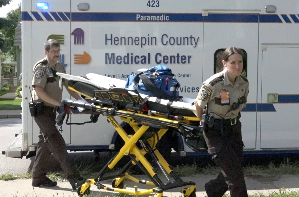 The photo shows two Hennepin EMS employees.