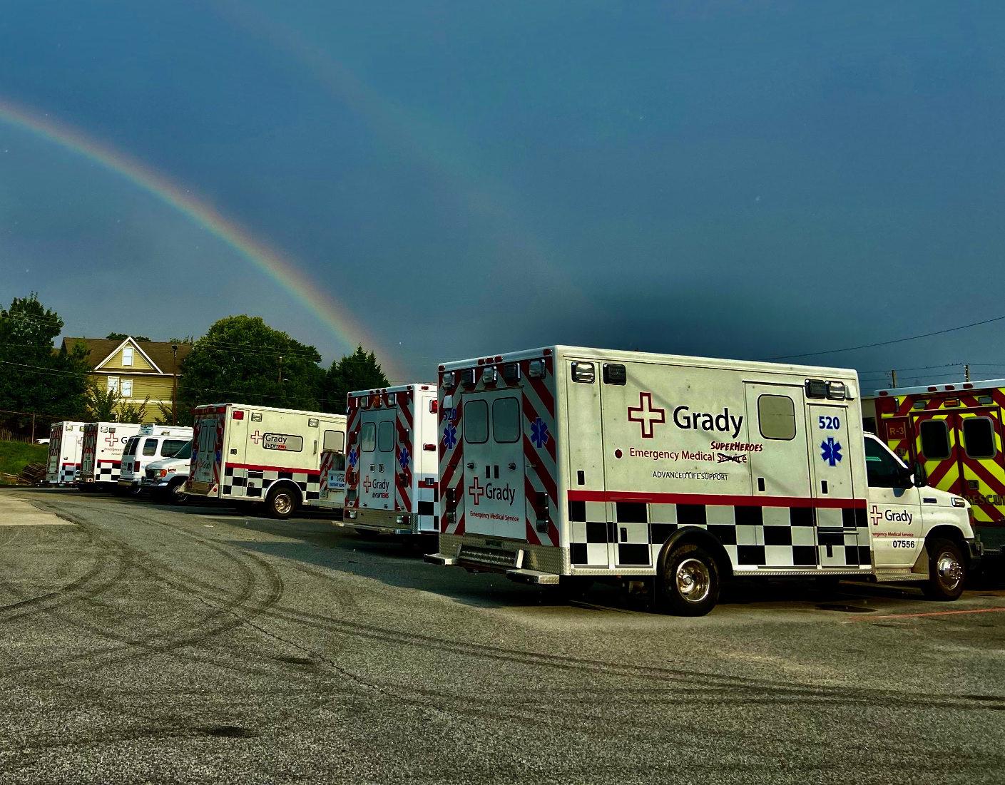 Grady EMS ambulances and a rainbow.