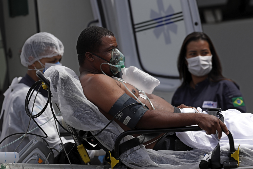 A 41-year-old patient suspected of having COVID-19 arrives from an ambulance to the HRAN public hospital in Brasilia, Brazil.