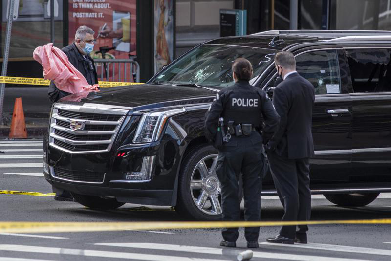 Los Angeles Police Department investigates the scene of a drive-by shooting at 7th and Figueroa Streets where an Uber driver was shot and killed Tuesday, April 27, 2021, in downtown Los Angeles.