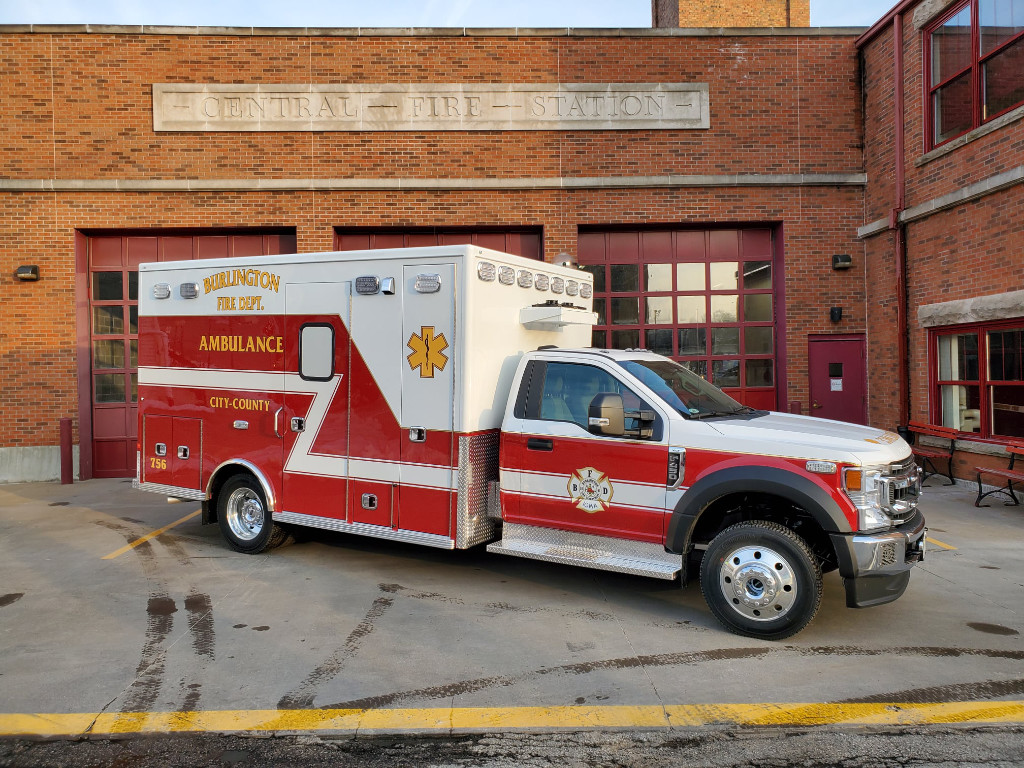 The photo shows a Burlington Fire Department ambulance parked outside the station.