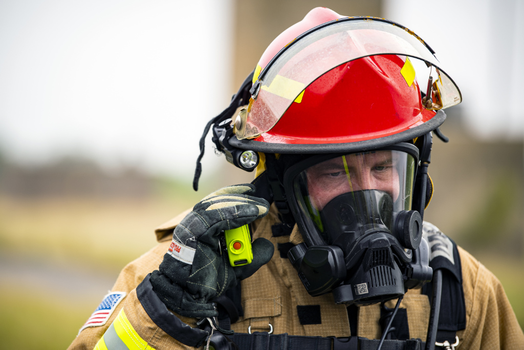 A firefighter from the 423rd Civil Engineer Squadron, listens to a walkie-talkie during an exercise at RAF Molesworth, England, Sept. 23, 2020.