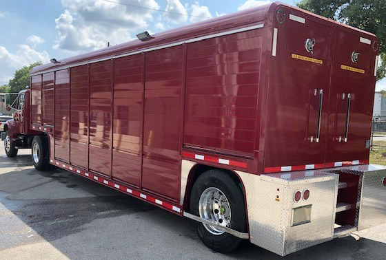 Like-new Fire and Rescue unit featuring custom rear bumper with built-in steps.
