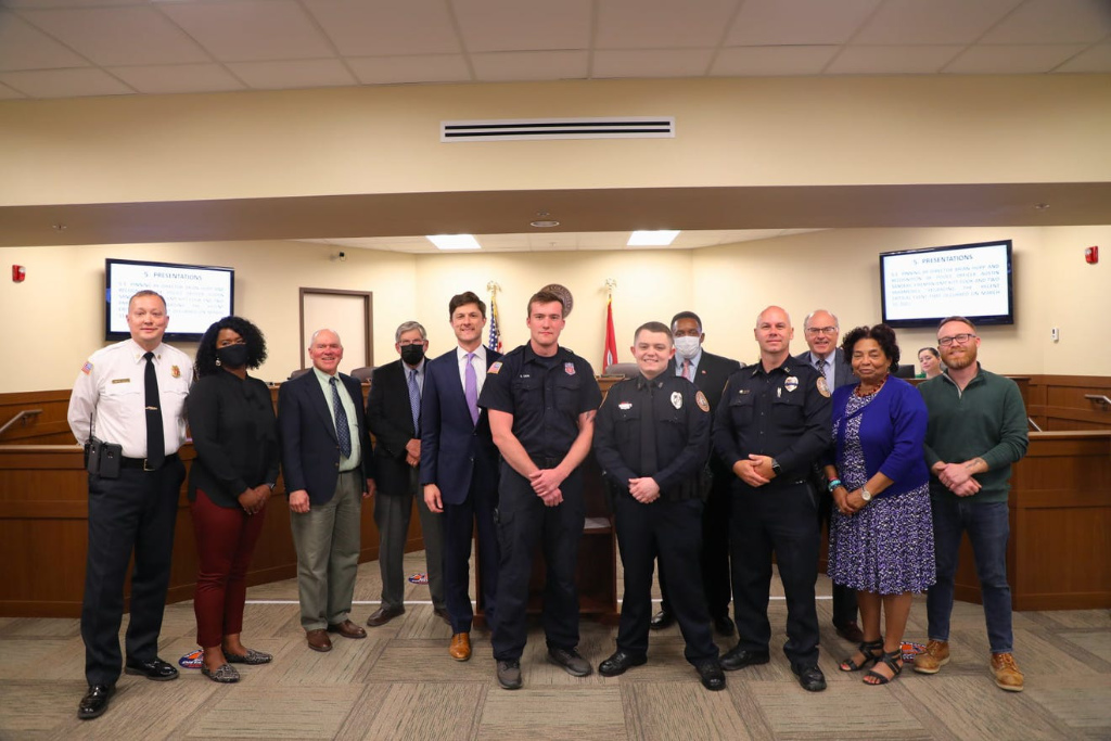 In this group photo, police and paramedics are recognized for their efforts to deliver a baby.