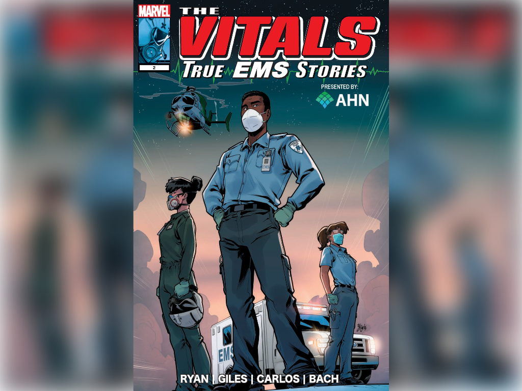 """The new comic book, """"The Vitals: True EMS Stories,"""" features stories of EMS providers serving the community through the worst of the COVID-19 pandemic. The comic book cover shows an EMS standing in a blue shirt with his hands on his hips."""
