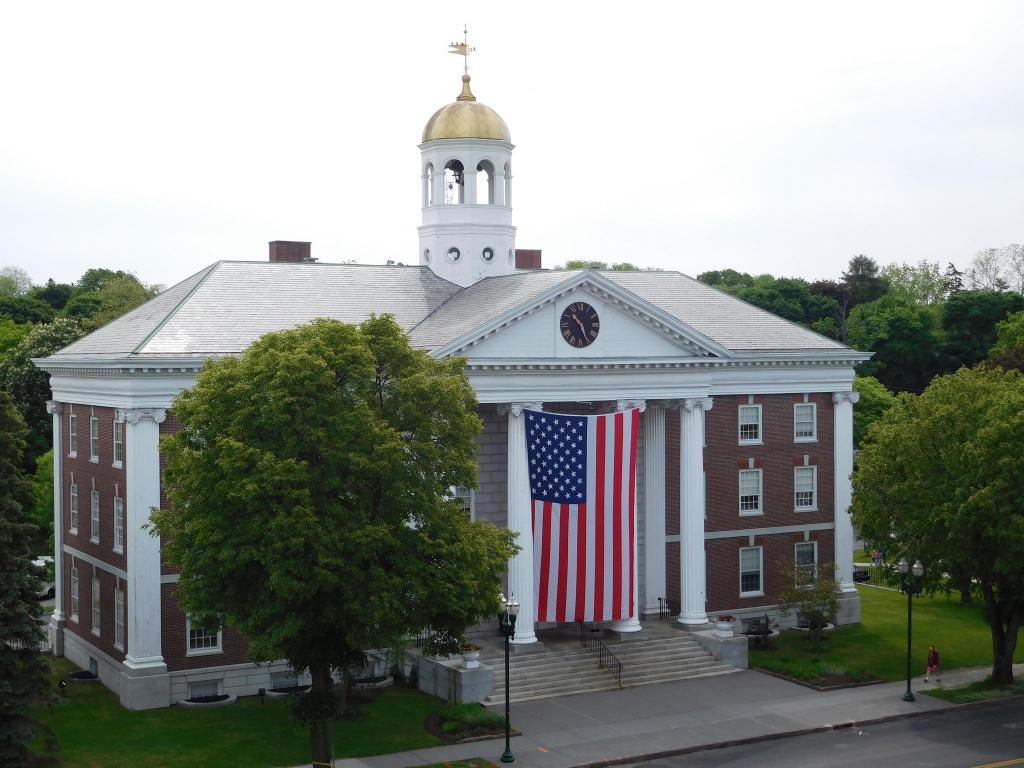 A large flag hangs off of Auburn City Hall.