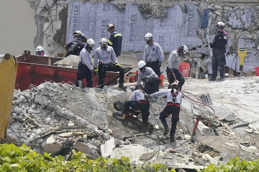 South Florida Urban Search and Rescue team look through rubble for survivors at the partially collapsed Champlain Towers South condo building in Surfside, Fla., Monday, June 28, 2021.