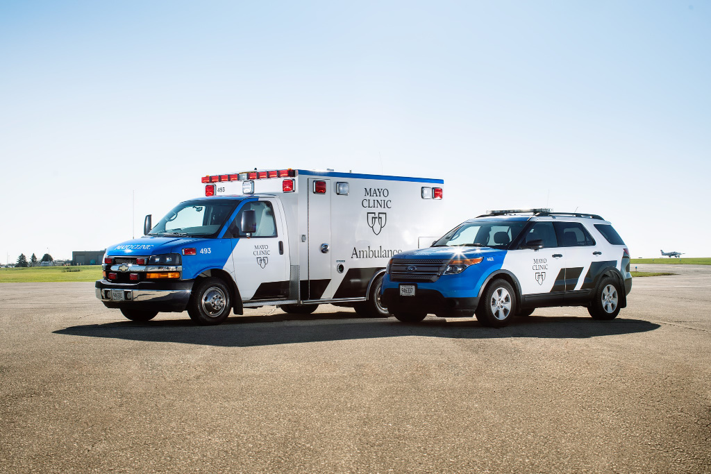 The photo shows a Mayo Clinic ambulance and an SUV.