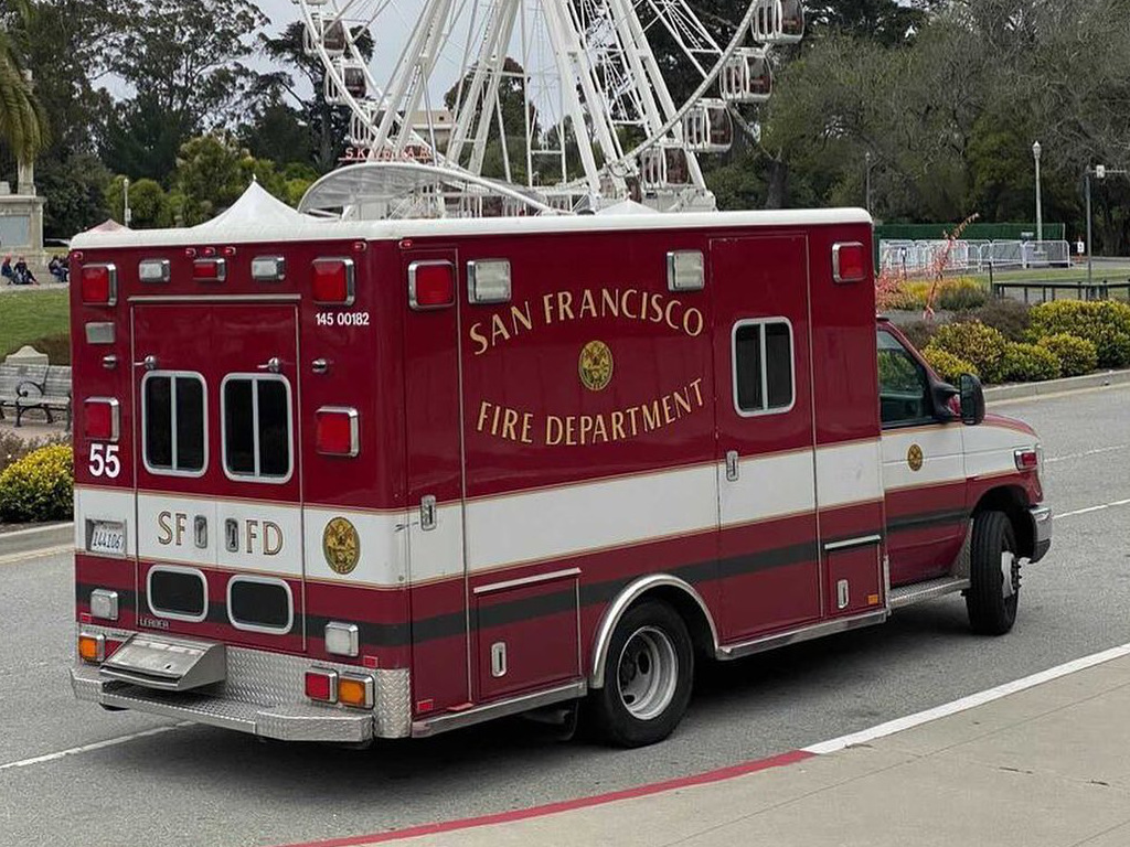 The image shows a parked San Francisco ambulance.
