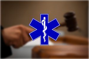 A Star of Life is imposed over a hand holding a gavel.