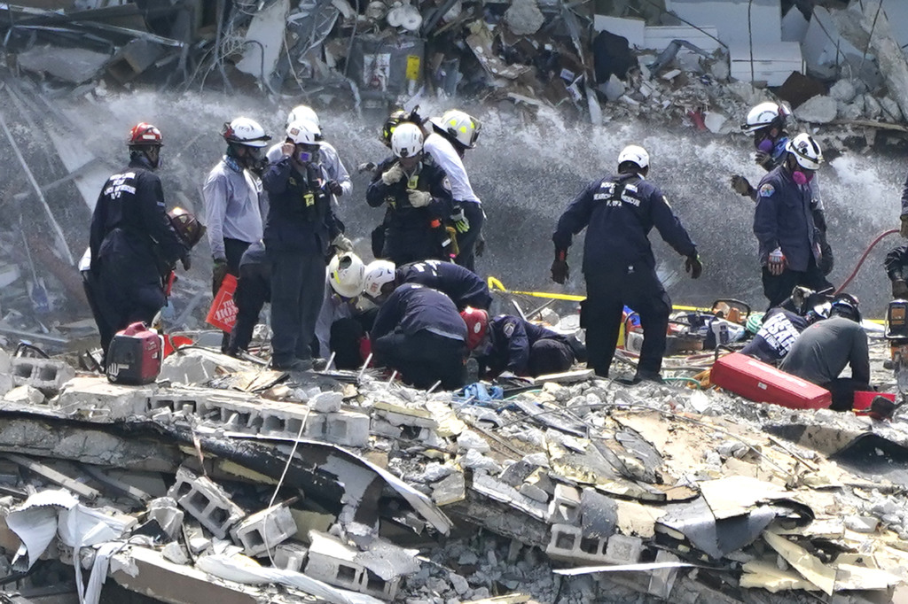 Rescue workers search the rubble of the Champlain Towers South condominium, Saturday, June 26, 2021, in the Surfside area of Miami.