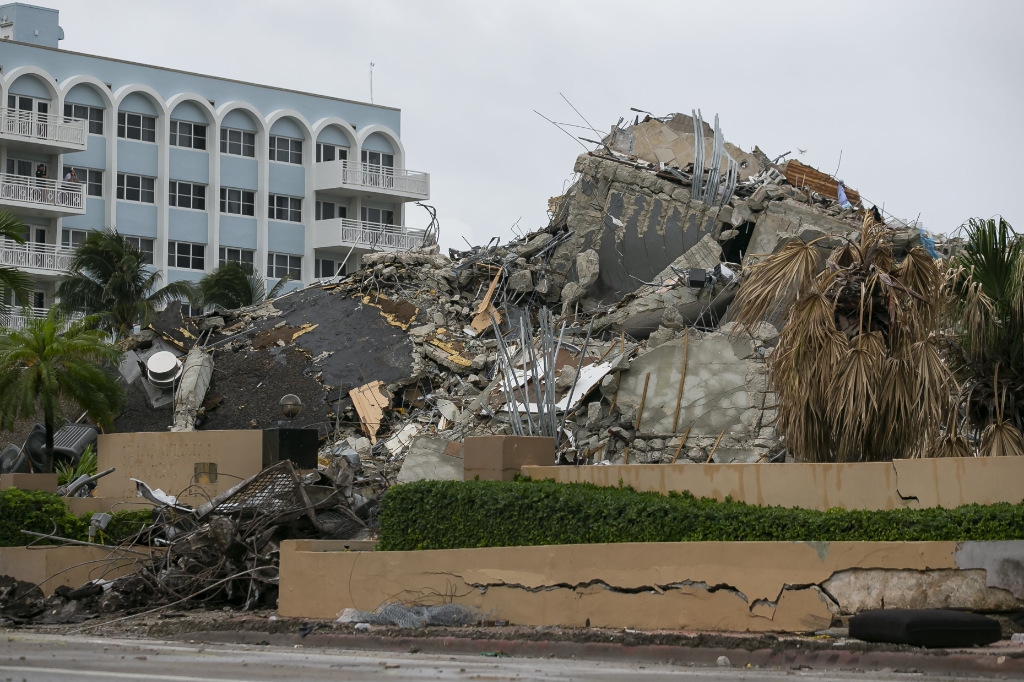 Rubble and debris of the Champlain Towers South condo can be seen Tuesday, July 6, 2021 in Surfside, Fla.
