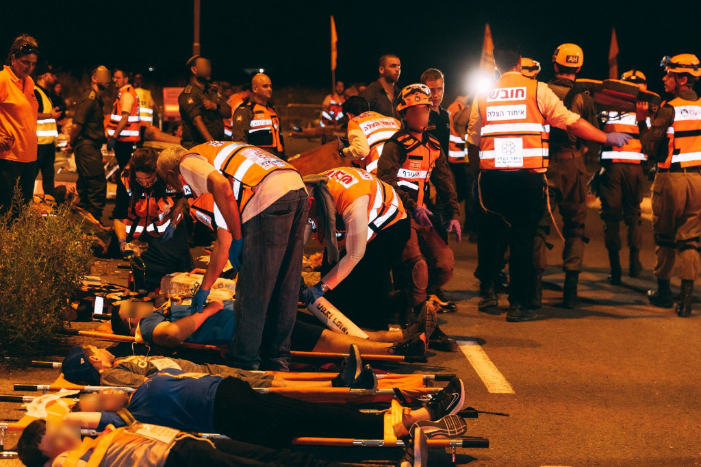 Simulated victims lie on stretchers.