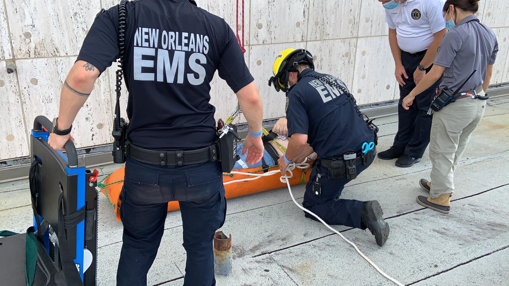 A New Orleans EMS crew training on a patient in a basket.