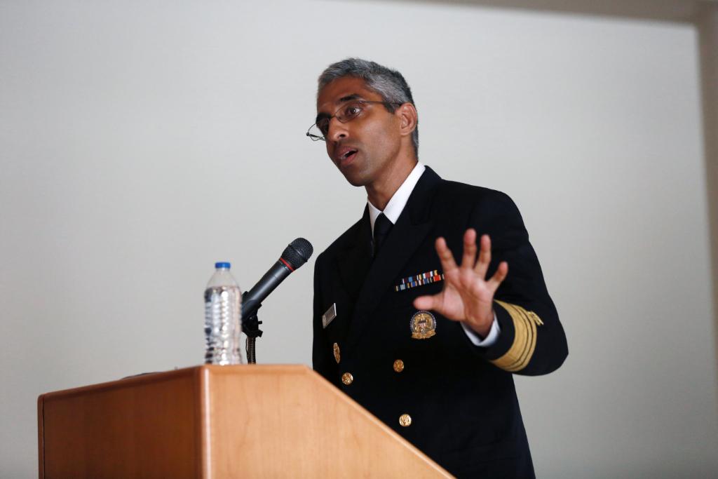 Surgeon General Vivek Murthy speaks at a podium.