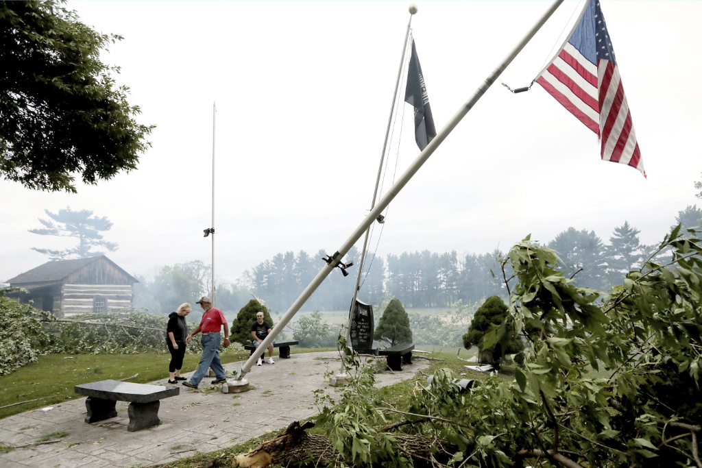 Jefferson County residents inspect damage at Dahnert Park, Thursday, July 29, 2021 in Concord, Wis., following an overnight storm.