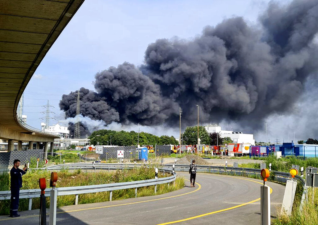 A dark cloud of smoke rises above the chemical park in Leverkusen, Germany, Tuesday, July 27, 2021.