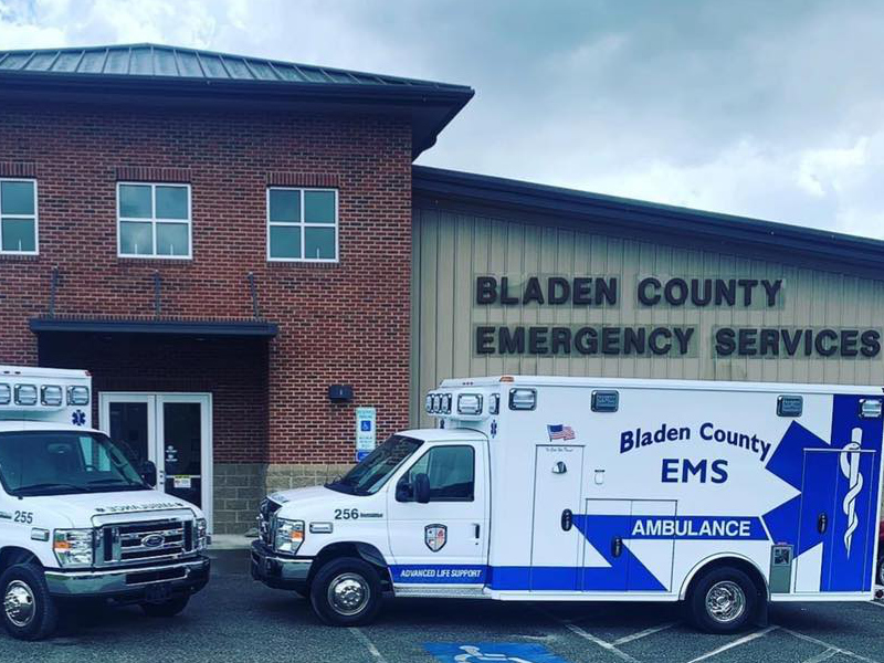 Bladen County EMS ambulances parked hood to hood.