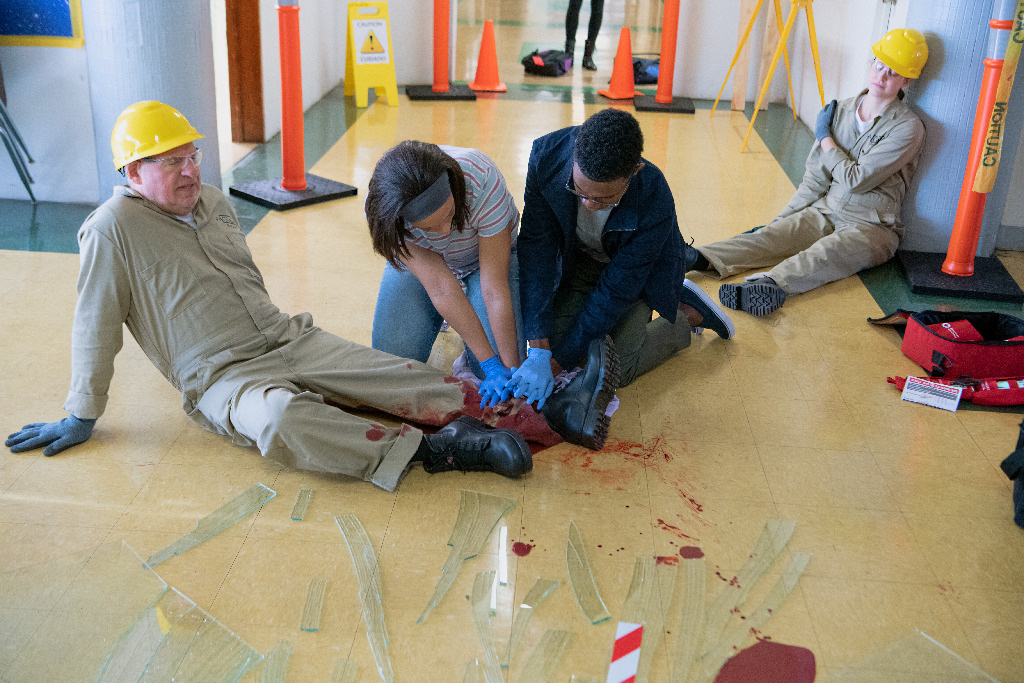 Providing first aid to hurt workers
