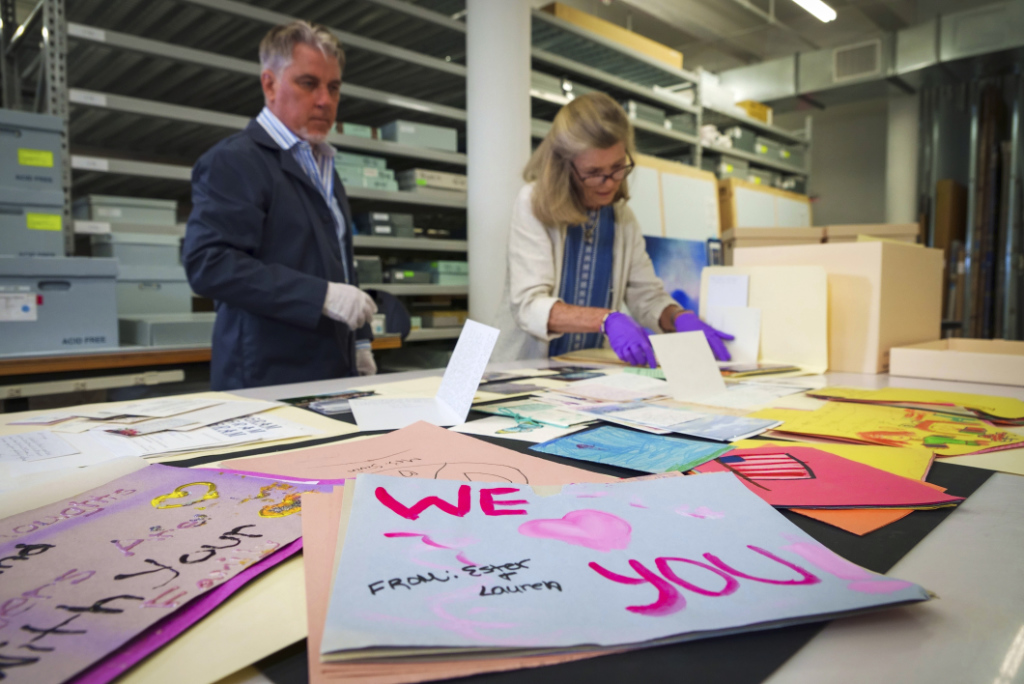 Jan Ramirez, chief curator at the 9/11 Memorial & Museum, right, sifts through a collection of condolence cards for a victim of 9/11 that were donated to the museum's archive, July 16, 2021, in Jersey City, N.J.