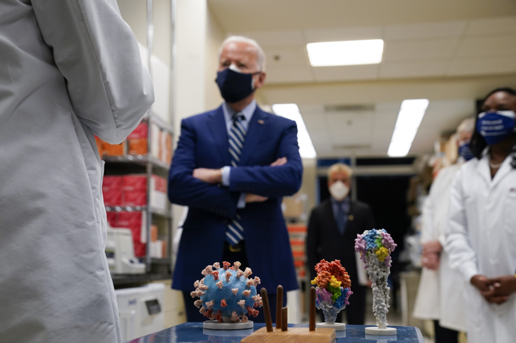 In this Feb. 11, 2021 file photo, President Joe Biden visits the Viral Pathogenesis Laboratory at the National Institutes of Health (NIH) in Bethesda, Md.
