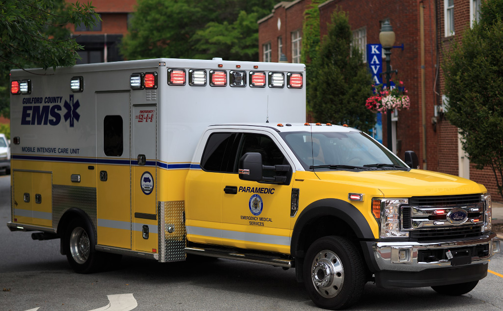 A yellow and white Guilford County EMS ambulance